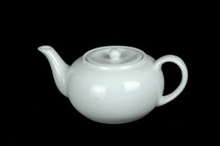 White Teapot. Isolated on a black background Royalty Free Stock Photos