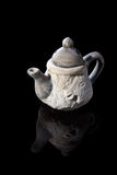 The white teapot. A white teapot with a relief of a horse Stock Photos