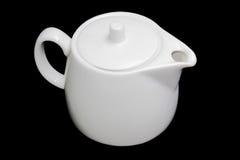 White teapot on a black background Stock Photo