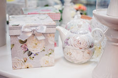 White teapot and a box with a picture of roses Stock Images