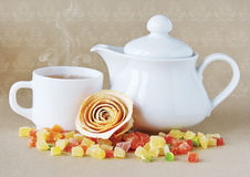 White teapot and a cup of tea. Royalty Free Stock Images