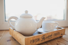 White teapot and cup on a wooden tray Royalty Free Stock Images