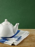 White teapot and dishcloth Royalty Free Stock Image