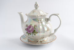 White teapot painted with rose. Isolated stock image