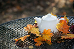 White teapot on a table Stock Images