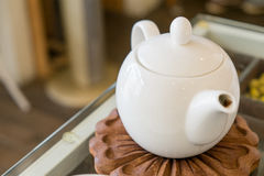 White teapot on the table Royalty Free Stock Images