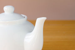 White teapot on a table Royalty Free Stock Image