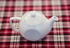 White teapot on tablecloth Royalty Free Stock Photos