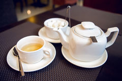 White teapot with tea Cup, saucer and teaspoon Stock Photo