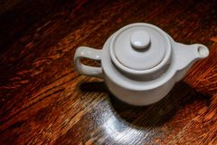 White teapot top view on vintage wooden table Royalty Free Stock Photography