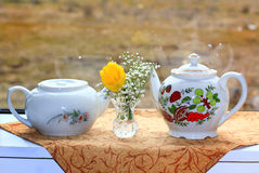 White Teapots and Flowers Stock Photo