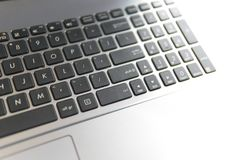 White technological background. Laptop computer on a wooden desk. Top view copy space royalty free stock image
