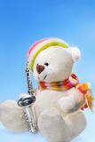 White Teddy Bear. With Saxophone on blue background stock photo