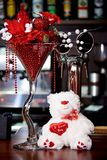 White teddy bear on the bar with decoration for the holiday. White teddy bear on the bar with decoration for holiday royalty free stock photography