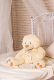 White teddy bear on the bed Royalty Free Stock Photos