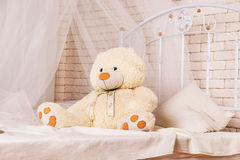 White teddy bear on the bed Royalty Free Stock Images
