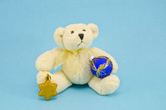 White teddy bear with christmas toys Stock Photos