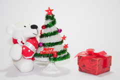 White teddy bear with christmas tree Royalty Free Stock Image