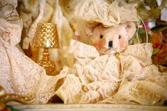 White Teddy Bear at Christmas. White christmas teddy bear wearing lace dress and hat sitting on a table during the holidays stock images