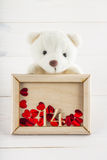 White teddy bear holding plate with hearts. Concept on 14 February. White teddy bear holding plate with hearts. Concept on 14 February stock photos