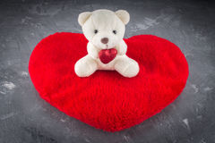 White teddy bear with love letter on red heart  gray background. Say i  you for valentine `s day concept. Stock Photos