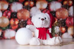 White teddy bear with presents. And christmas toy royalty free stock images