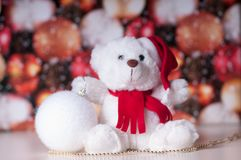 White teddy bear with presents. And christmas toy stock images