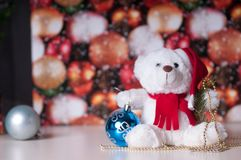 White teddy bear with presents. And christmas toy stock photography