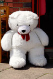 White teddy bear for sale outside shop Stock Photos