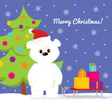 White teddy bear with sled with presents. Colorful vector illustration of a cute cartoon baby polar bear with a sled full of gifts standing near a Christmas tree Royalty Free Stock Photos