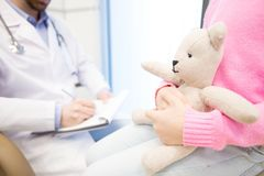 Teddy of girl. White teddybear in hands of little patient waiting for her doctor making prescriptions Stock Photography