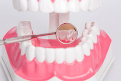 White teeth and dental instruments Stock Image