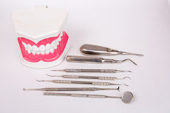 White teeth and dental instruments Stock Images