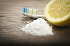 White teeth with lemon and baking soda. On wood Stock Images
