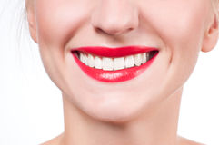 White teeth and red lips.  Perfect female smile after whitening teeth. Royalty Free Stock Photography