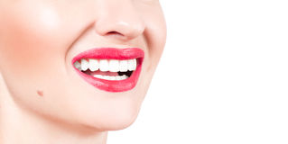 White teeth and red lips.  Perfect female smile after whitening teeth. Royalty Free Stock Images