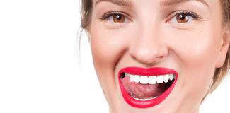 White teeth and red lips.  Perfect female smile after whitening teeth. Stock Image