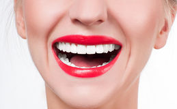 White teeth and red lips.  Perfect female smile after whitening teeth. White teeth and red lips. Perfect female smile after bleaching. Dental care and whitening Stock Photos