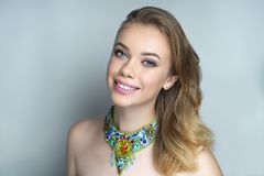 White teeth smile woman accessory necklace with blue beads stock images