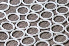 White Teflon Seals. A photo taken on some white O-ring Teflon sealing packing Royalty Free Stock Image