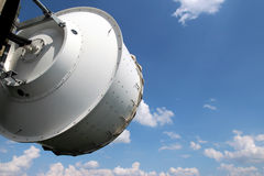White telecommunication dish under cloudy sky Stock Images