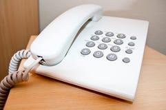 White telephone on desk Royalty Free Stock Photography