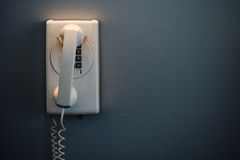 White Telephone Mounted On A Wall Stock Images