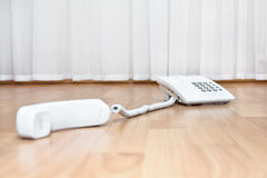 White telephone on the parquet Stock Images