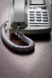 White telephone on wooden desk Stock Photography