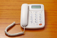 White telephone on wooden table Royalty Free Stock Photos