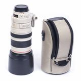 White telephoto lens with its cover Royalty Free Stock Images