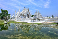 White Temple in Chiang Rai. Wat Rong Khun, more well-known among foreigners as the White Temple, is a contemporary unconventional Buddhist temple in Chiang Rai Royalty Free Stock Photos