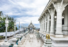 White Temple. Columns and walkway of a modern buddhist temple after the rain in Krabi, Thailand Royalty Free Stock Photo