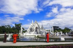 White Temple After Earthquake and Buddhist Monks. Stock Image